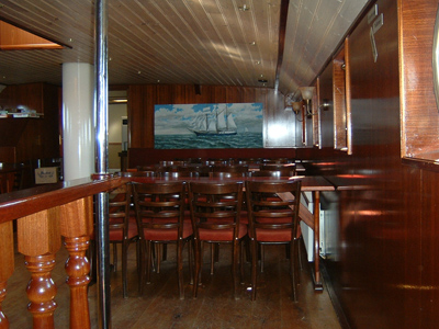 The bar in the Salon. The meeting place during a management training, catering, wedding or in case the ships operates as a hotel ship.